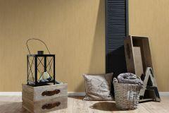32883-2 cikkszámú tapéta.Egyszínű,különleges felületű,textil hatású,csíkos,arany,súrolható,illesztés mentes,vlies tapéta